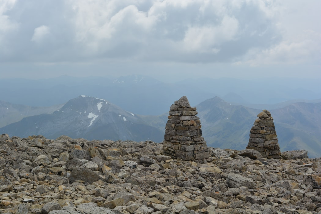 Stone structures and cloud-filled views at the summit of Ben Nevis
