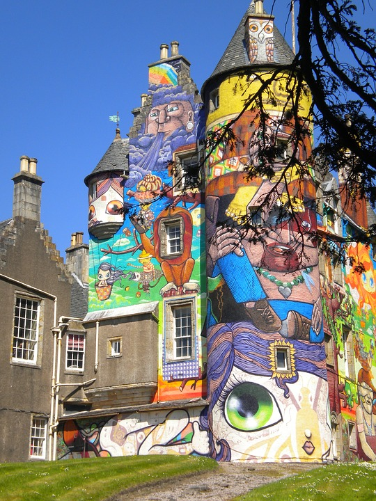 A colourful graffiti mural on the side of Kelburn Castle in Scotland