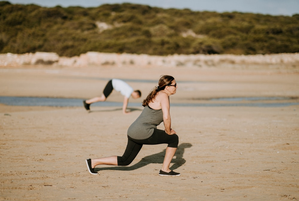 woman doing exercises on the beach